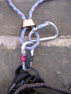 Clip a second karabiner between the rope and belay point