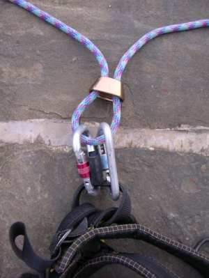 Clip a second karabiner through the rope and belay point